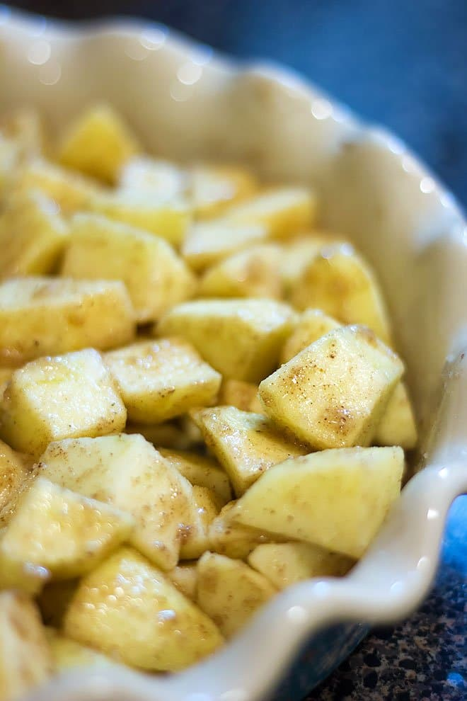 The apple cubes are mixed with spices and ready for the topping