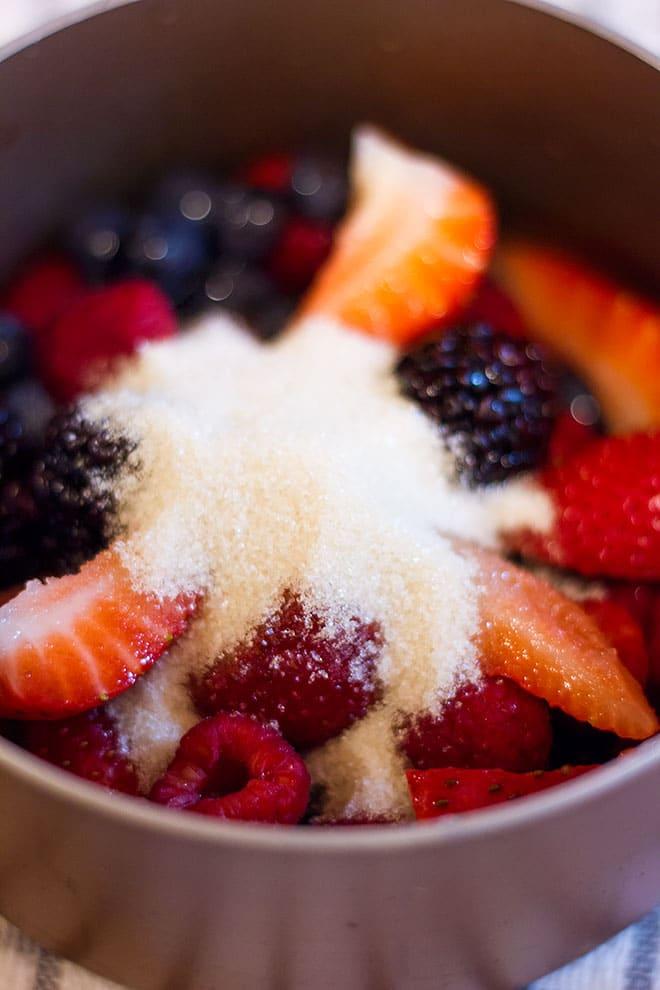 berries and sugar in a saucepan.