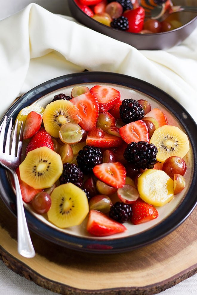 Fruit salad served in a plate ready to be eaten.