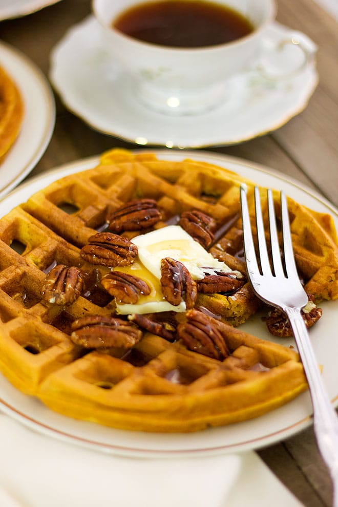 pumpkin waffles topped with butter and honey.