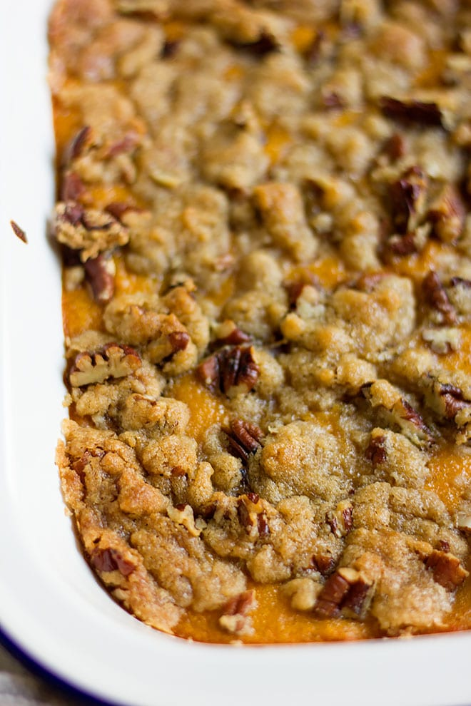 Side image of sweet potato casserole with pecans.
