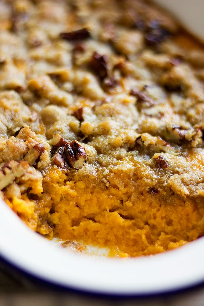 Showing rich and delicious sweet potato casserole in serving dish.
