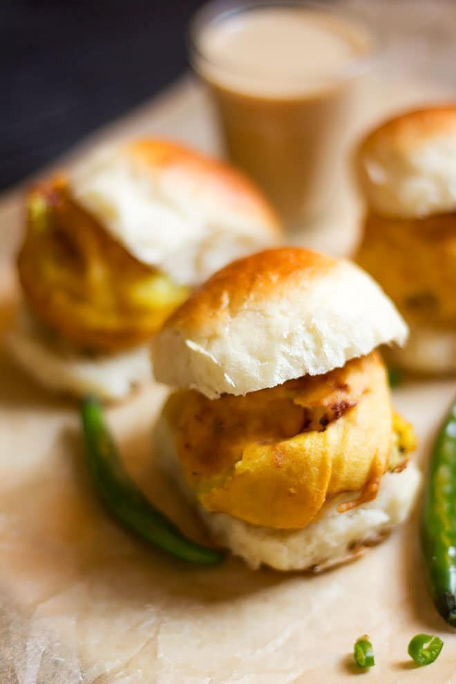 vada pav served on brown parchment paper.