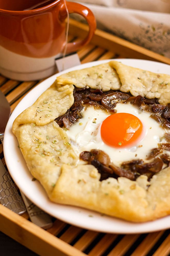 Mushroom and onion galette served in a plate.