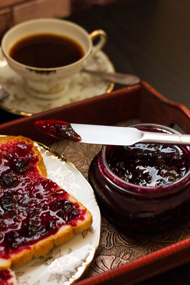 Berry jam spread over a toast.
