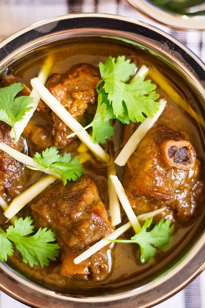 Close up shot of tender lamb in coconut curry.