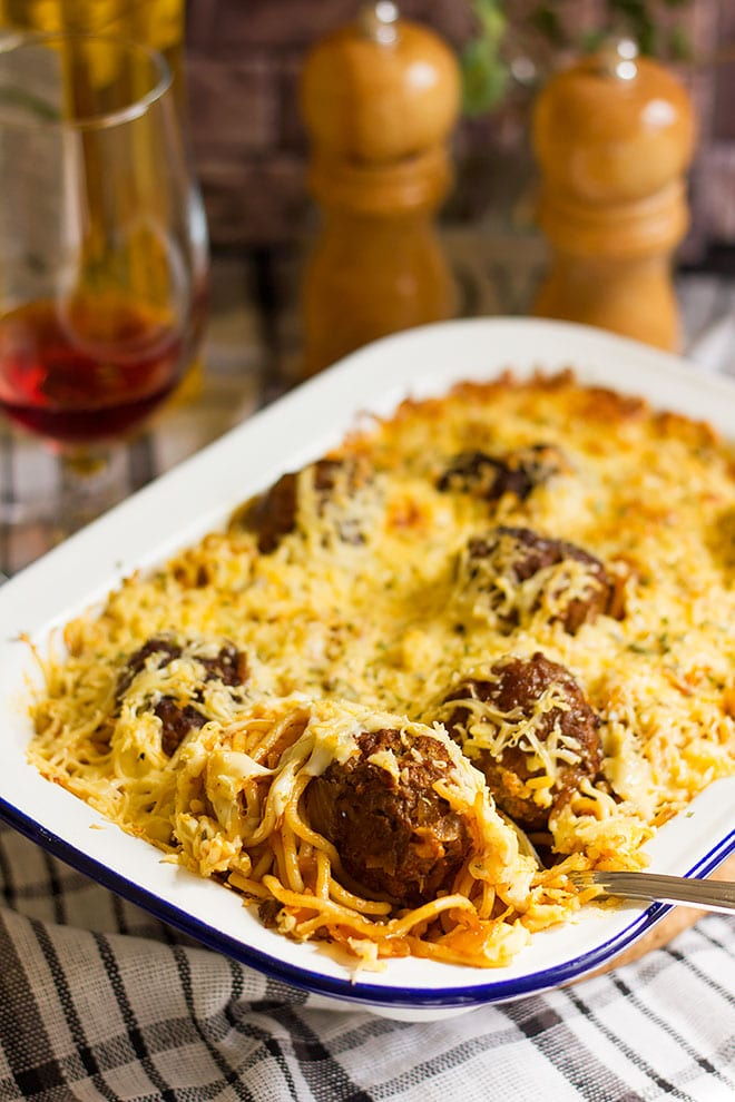 Meatball casserole with spaghetti and cheese.
