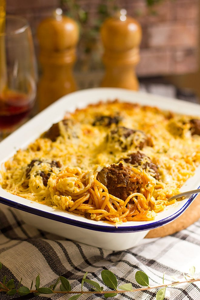 close up image of meatball casserole showing spaghetti.