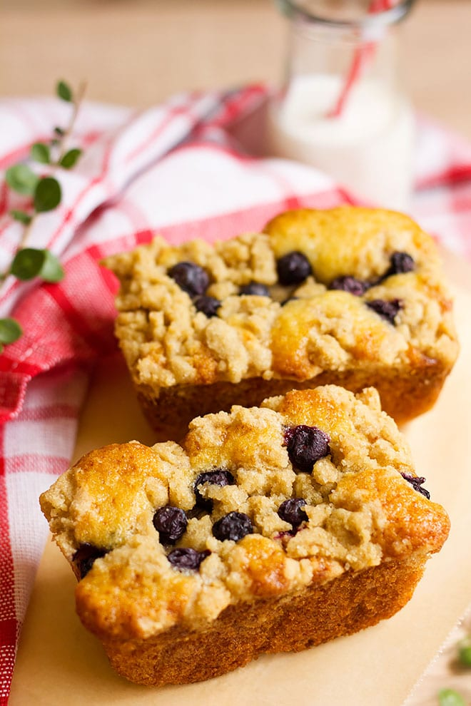 Mini Blueberry coffee cakes on parchment paper.