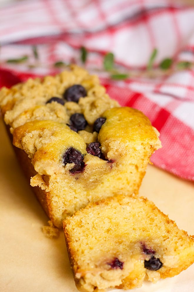 Sliced blueberry coffee cake showing tender crumbs.