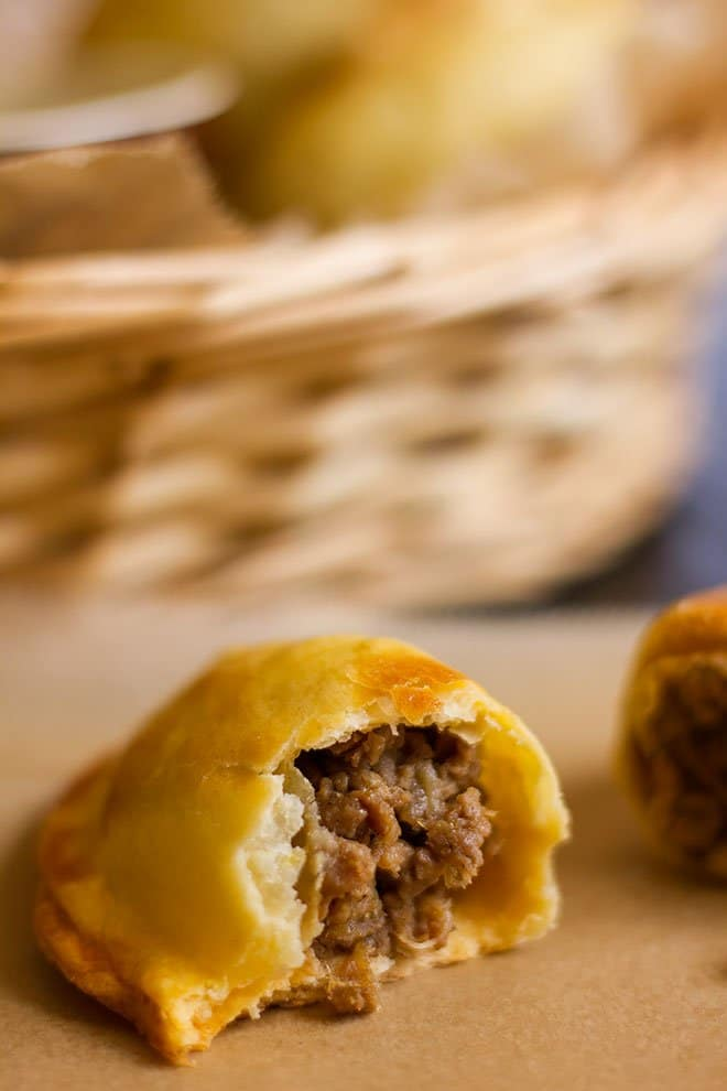 Close up image of chicken empanadas showing the filling.