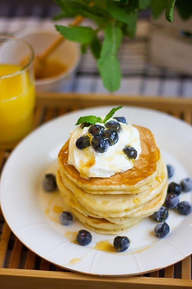 Yogurt pancakes served on a white plate.