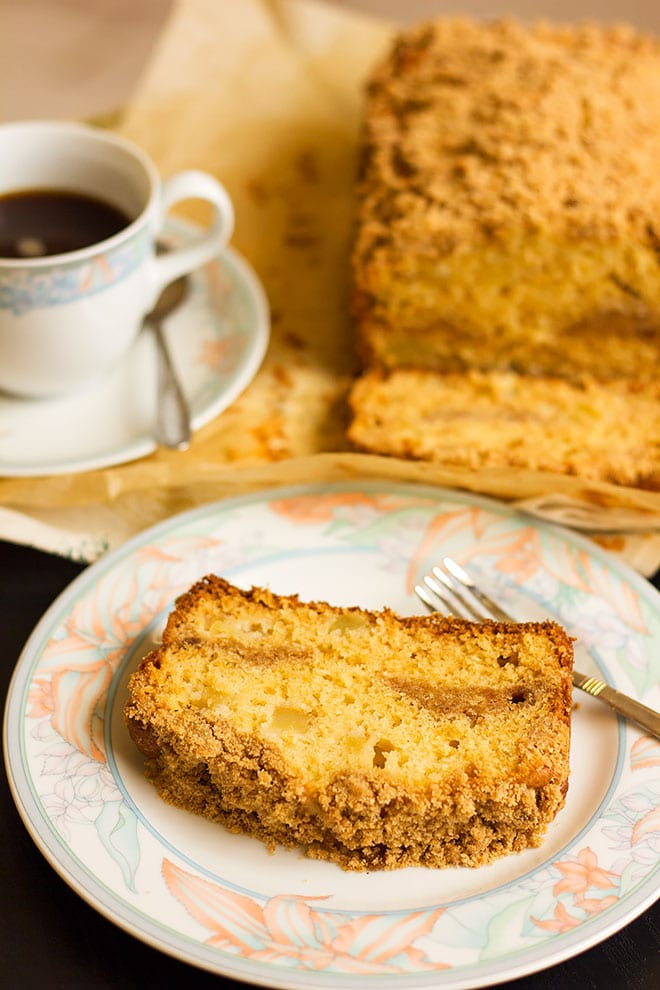 A slice of apple coffee cake served on a plate.