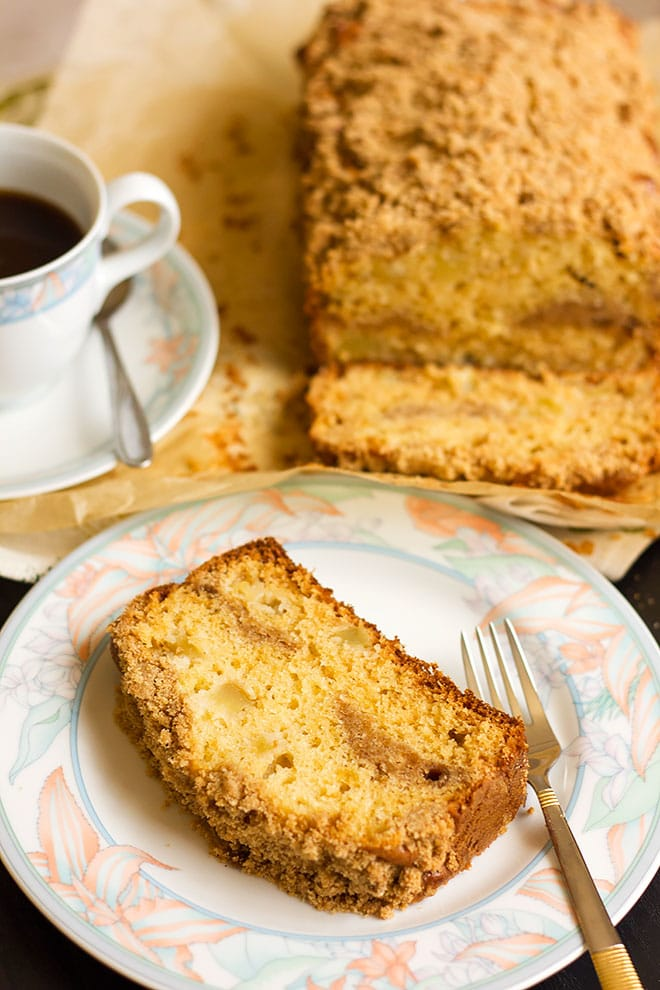 Coffee cake filled with chopped apples served.