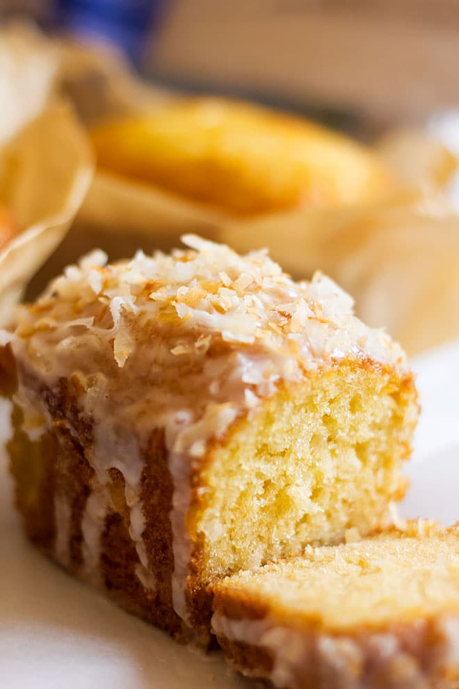 Close up image of coconut cake with icing.