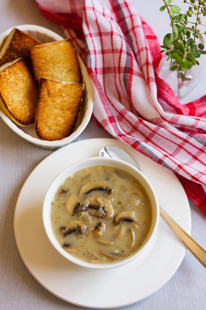 Cream of mushroom soup served in a bowl.