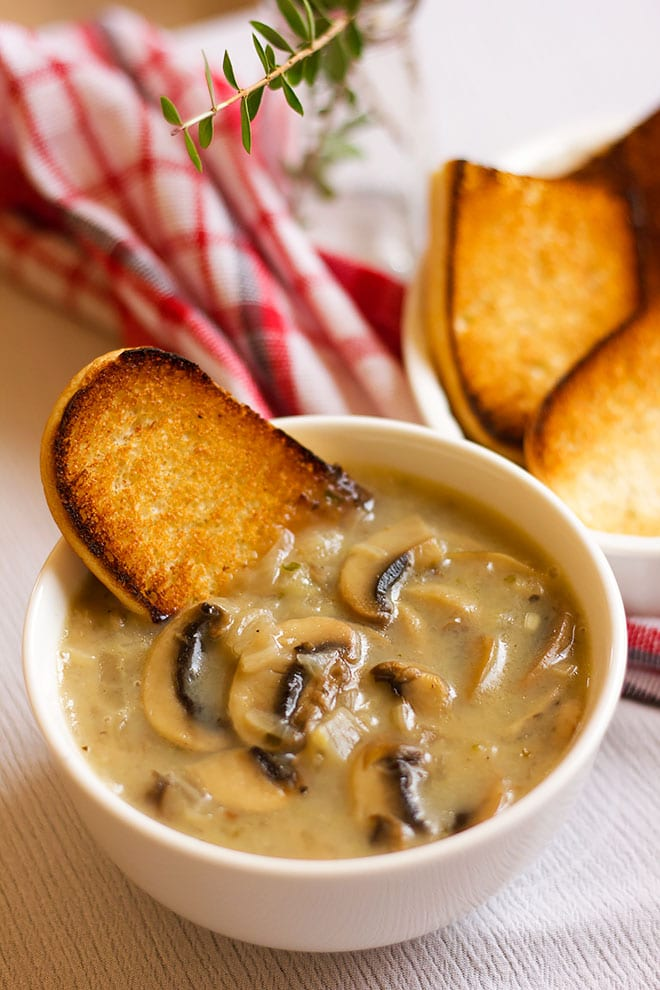 Cream of mushroom soup in a white soup bowl.