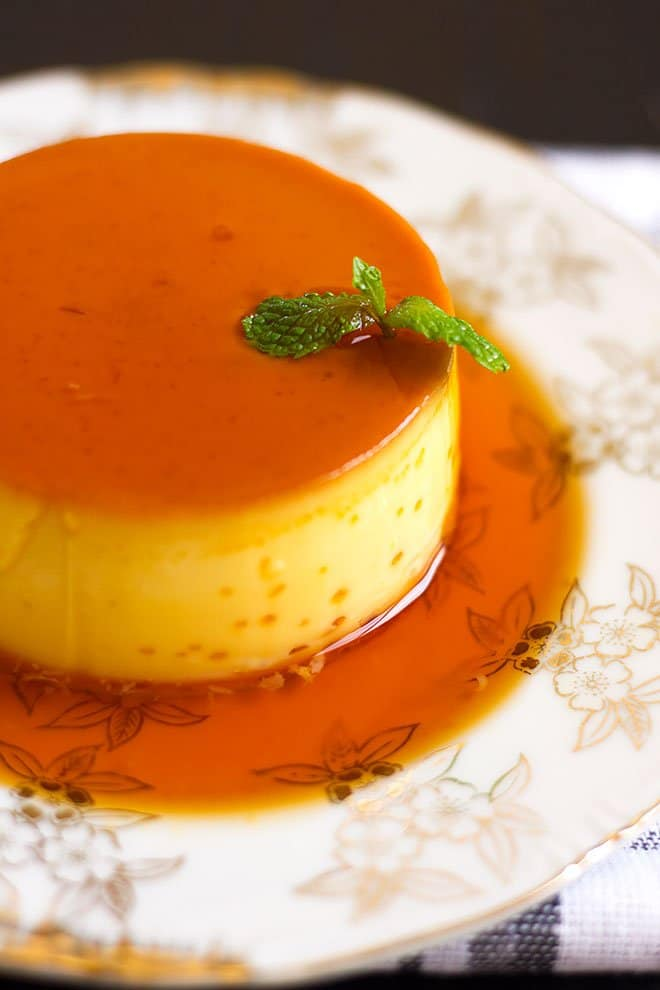 A closeup image of flan or creme caramel served in a plate.