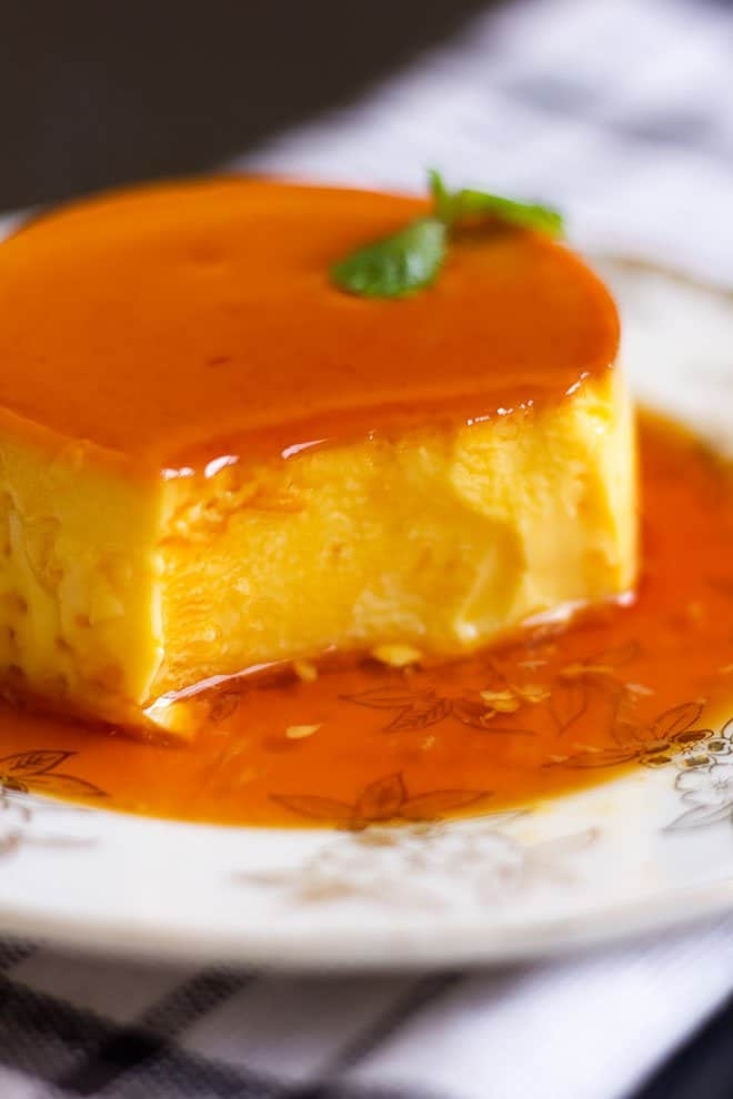 flan served in a white plate.