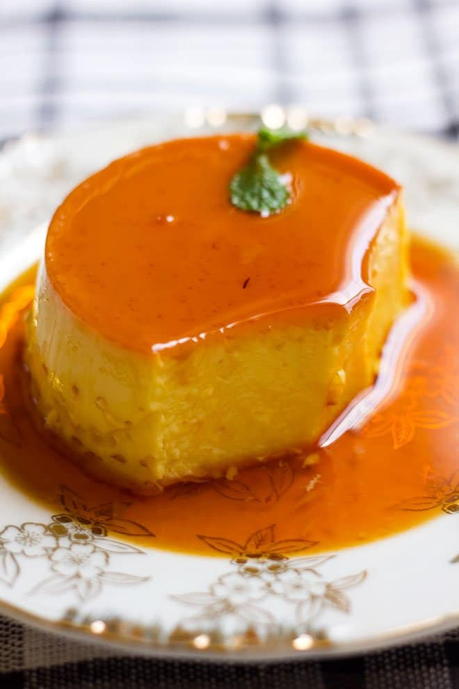 Creamy flan inverted in a plate.