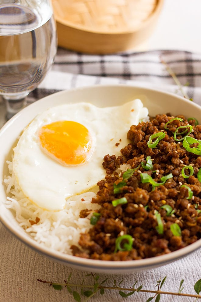 Korean recipe for ground beef served with sunny side up egg and rice.