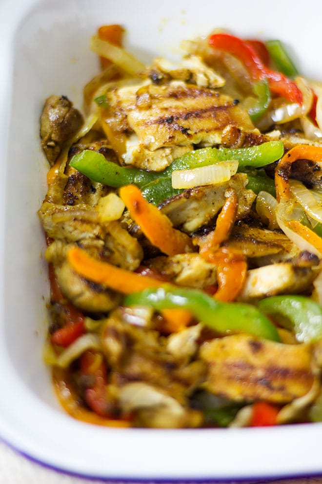 Tender chicken fajitas mixed with colorful peppers.