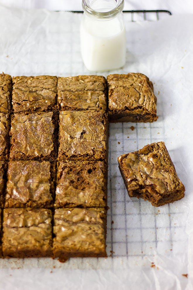 Nutella Brownies squares on white parchment paper.