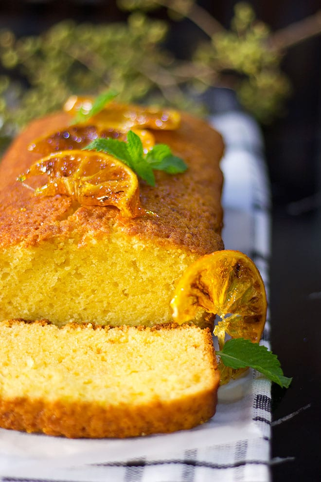 Side click of orange cake freshly baked.