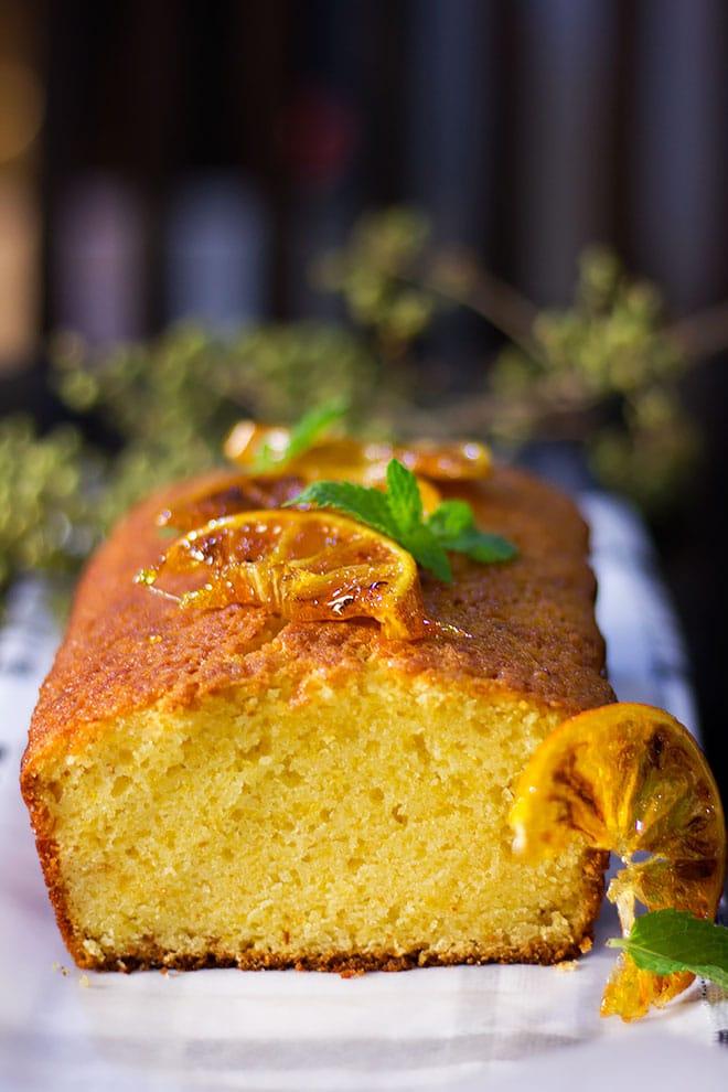 Close up image of moist orange cake showing tender crumbs.