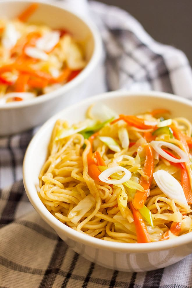 Two bowls of vegetable chow mein.