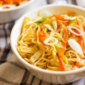 Chow mein in a small white bowl.