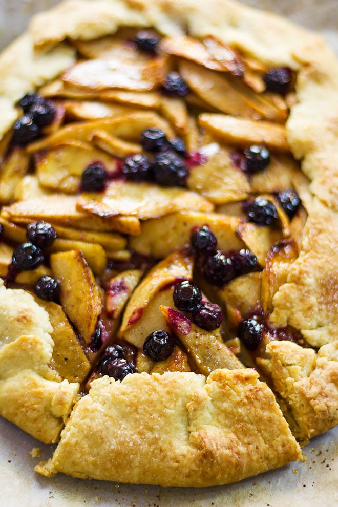 Juicy blueberries on apple and pear galette filling.