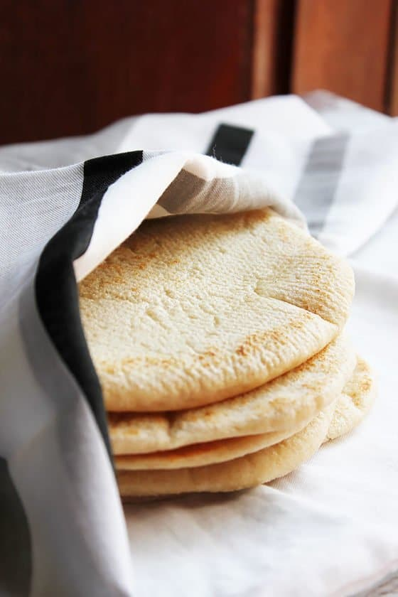 Stack of soft Pita bread covered with cloth. #pitabread