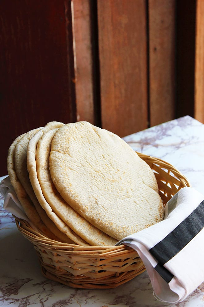 Side image of homemade pita bread in a basket. #pitabread
