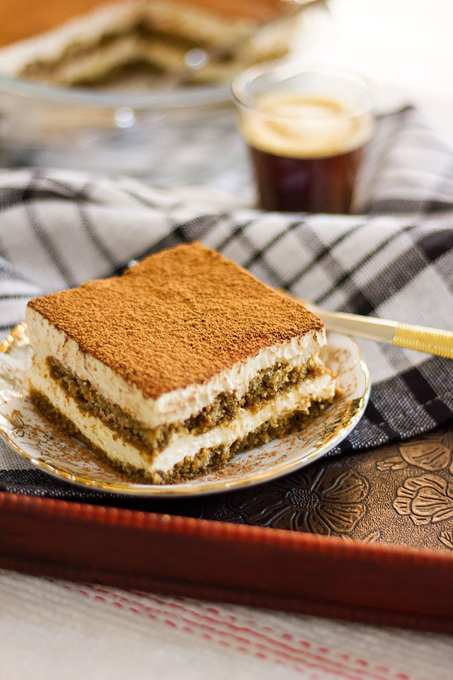 Side image of tiramisu dessert with layers of cream.