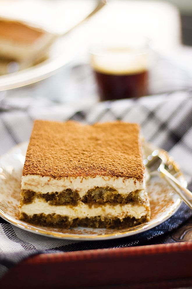 Close up image of tiramisu showing mascarpone cream.