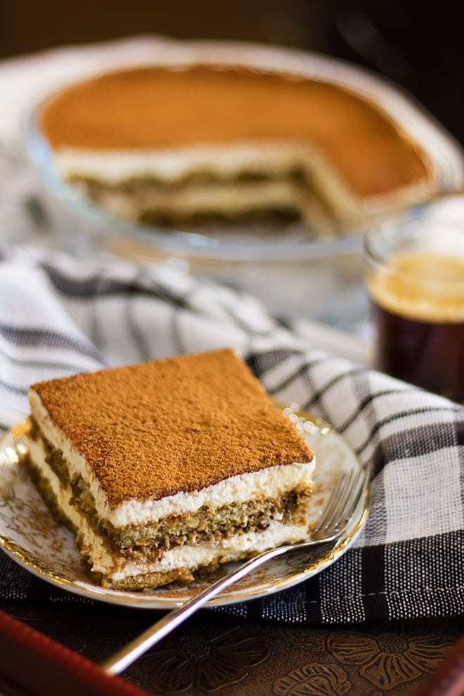 Side image of tiramisu dessert with a fork.
