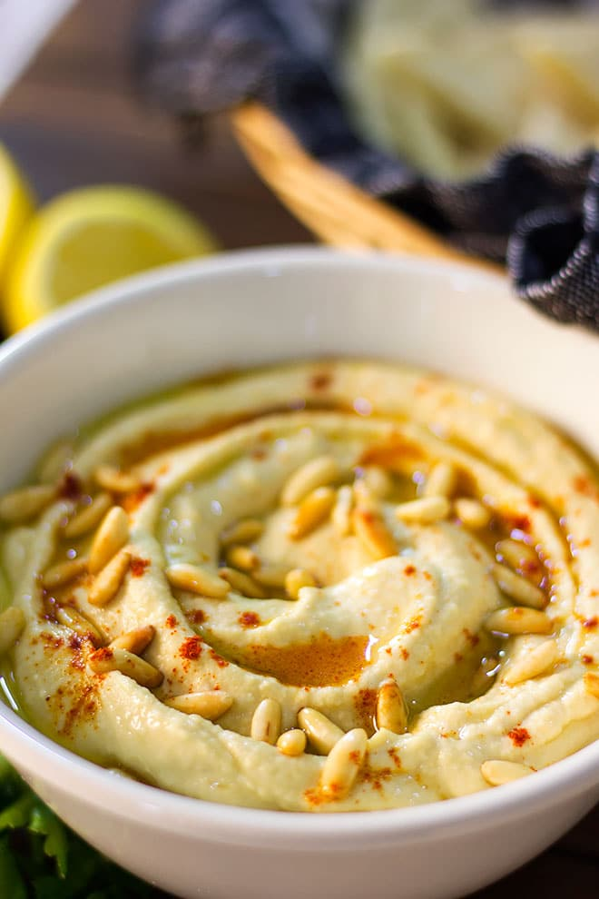 Close up image of hummus with tahini served in a bowl. #hummus