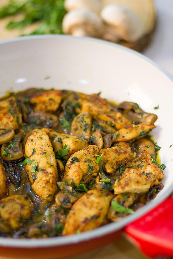 Tender chicken breast in a pan.