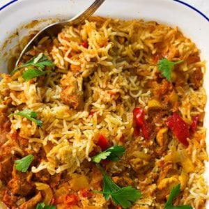 small image of baked chicken and rice.