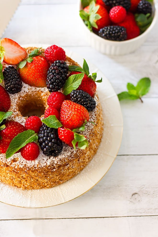 Angel food cake decorated with fresh fruit.