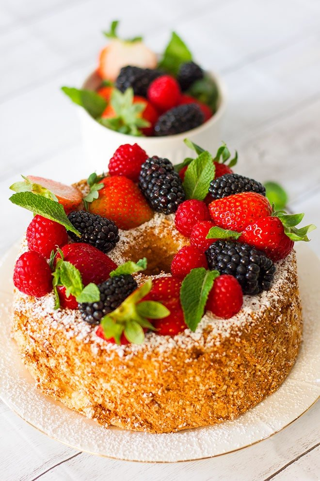 Close up image of angel food cake served on a plate.