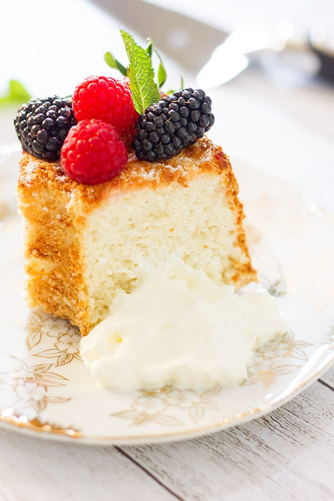 A slice of angel food cake showing tender crumbs.
