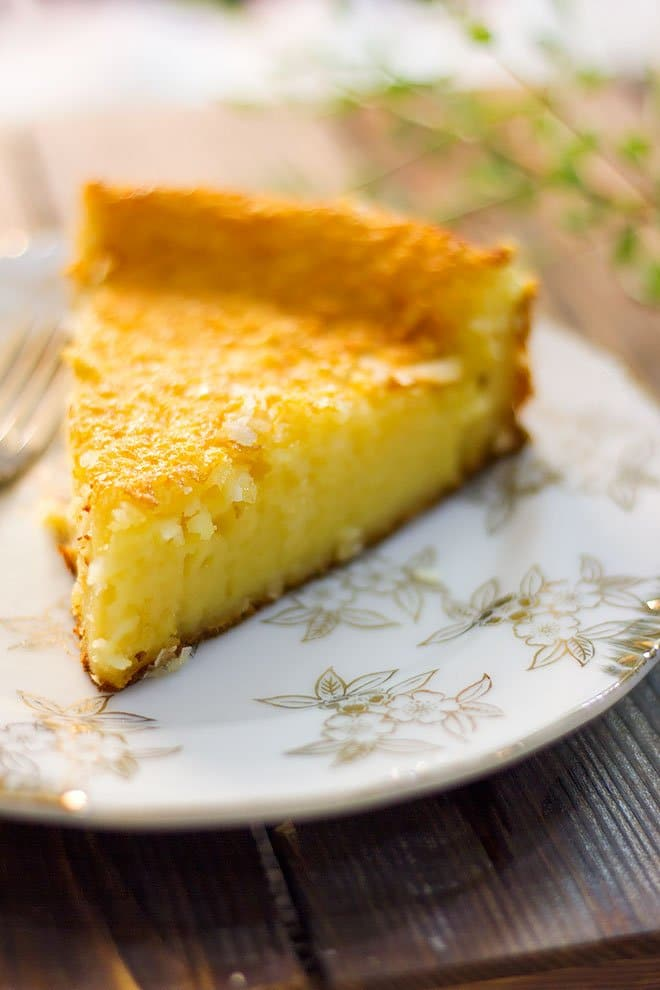 A slice of coconut pie served on a small plate.