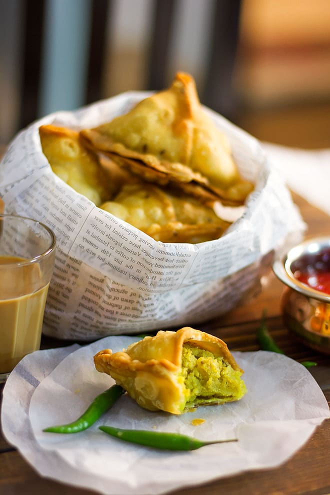 Showing the filling of aloo samosa.