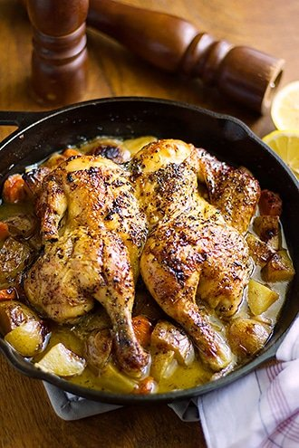 Image of roasted chicken in a skillet.