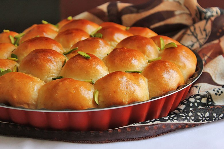 Freshly baked sweet buns in a pan.