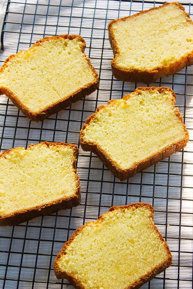Slice of pound cake on a cooling rack.