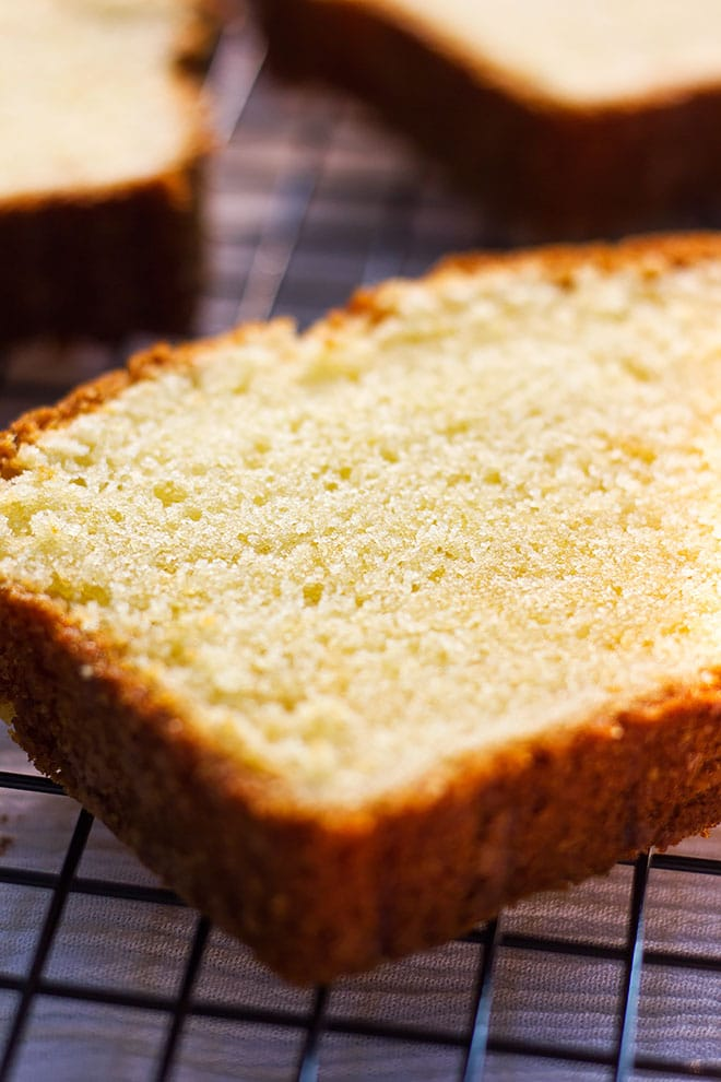 Close up image of pound cake slice with perfect crumbs.