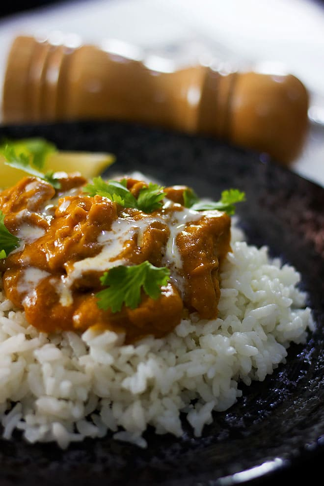 Butter Chicken served over white rice.